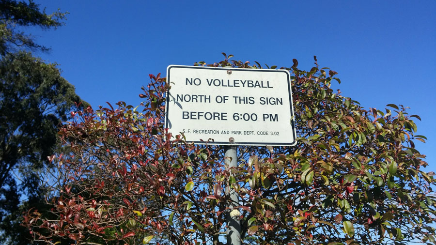 A sign restricting where and when volleyball can be played.