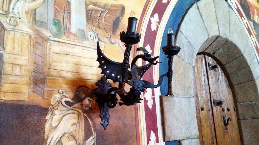 Light fixture inside Castello di Amarosa, showing a blend of vintage iron work and electric power.